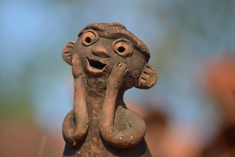 Oud beeldhouwwerk die verrassing uitdrukken stock foto's