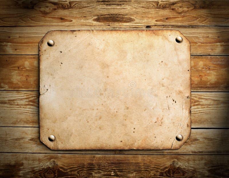Oud document op het hout stock foto