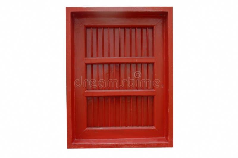 Oud en antiek houten rood die venster op witte achtergrond wordt geïsoleerd royalty-vrije stock fotografie