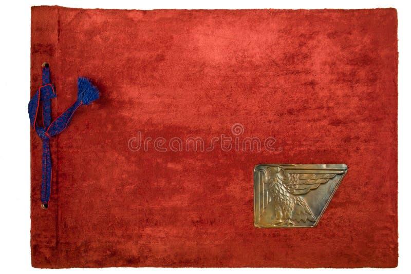 Oud fotoalbum met pluche rode dekking stock foto's