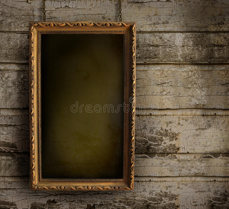 Oud frame tegen een geschilderde muur stock afbeelding