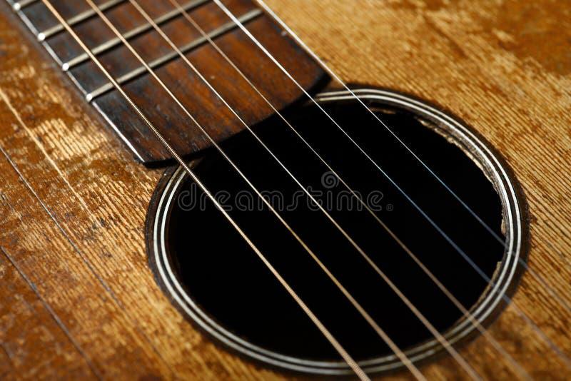Oud gitaardetail stock afbeelding