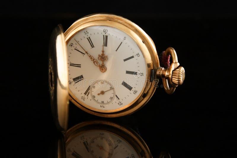Oud gouden horloge stock foto