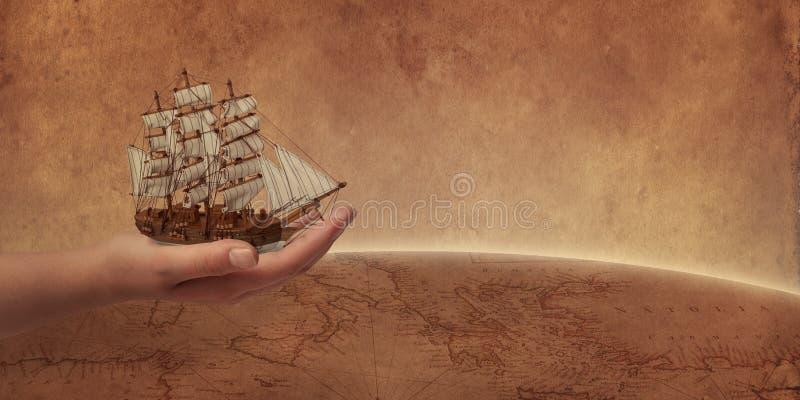 Oud het varen schip in hand concept Retro wereldkaart en bol op achtergrond royalty-vrije stock afbeelding