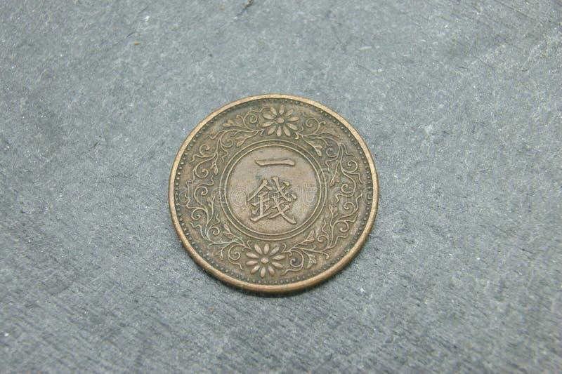Oud Japans muntstuk van 1 Sen stock afbeeldingen