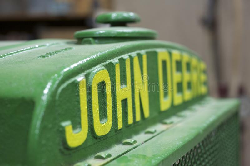 Oud John Deere-embleem stock afbeeldingen