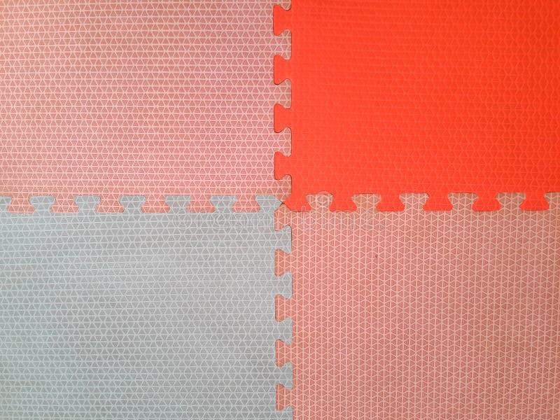 Oud Kleurrijk schuim of rubbervloer en kleurrijke zachte raad met exemplaarruimte royalty-vrije stock foto's
