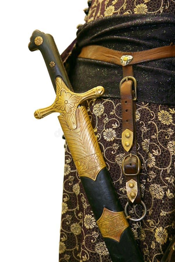 Oud kostuum met zwaard stock afbeeldingen
