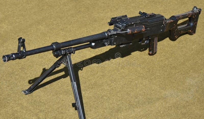 Oud machinegeweer op de vloer royalty-vrije stock afbeeldingen