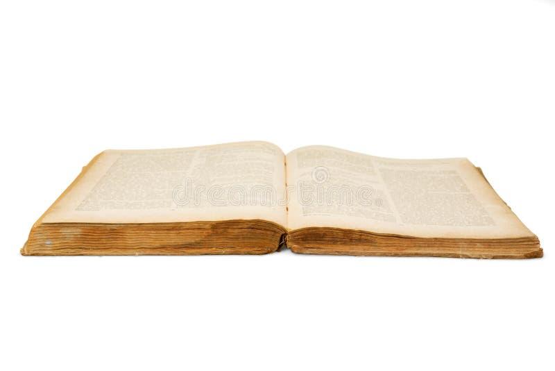 Oud open boek geïsoleerdn op witte achtergrond stock afbeeldingen