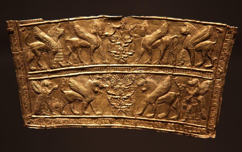 Oud Perzisch Iraans gouden breastplate fragment stock foto's