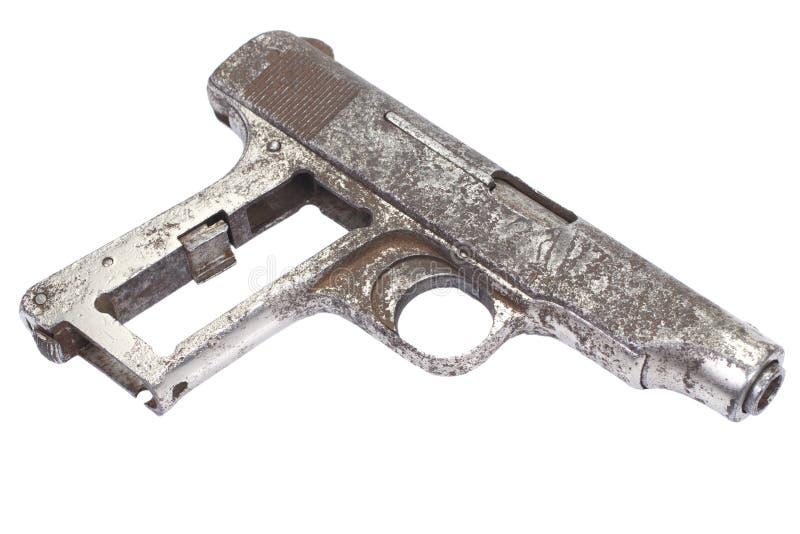 Oud roestig pistool stock foto