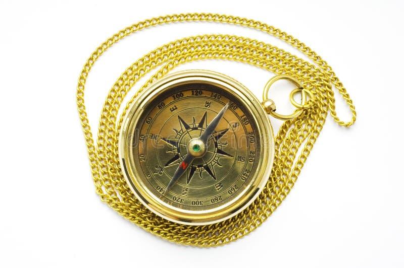 Oud stijl gouden kompas met ketting royalty-vrije stock afbeelding