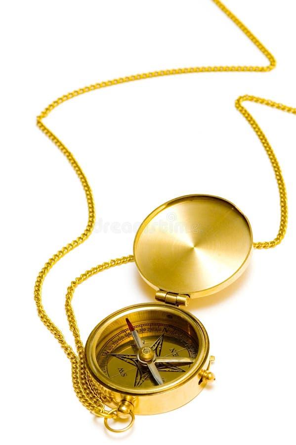 Oud stijl gouden kompas met ketting stock afbeelding