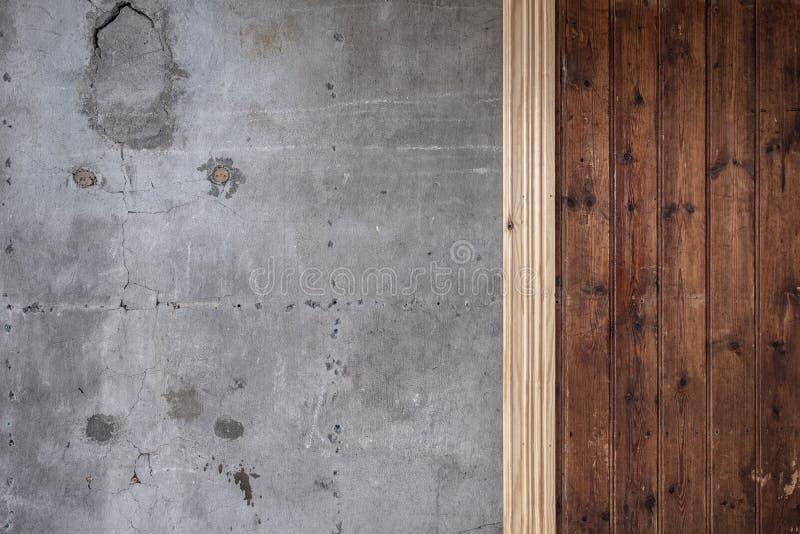Oud teruggewonnen hout en concrete muur stock foto's