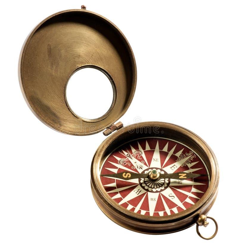 Oud uitstekend kompas op witte achtergrond stock afbeeldingen