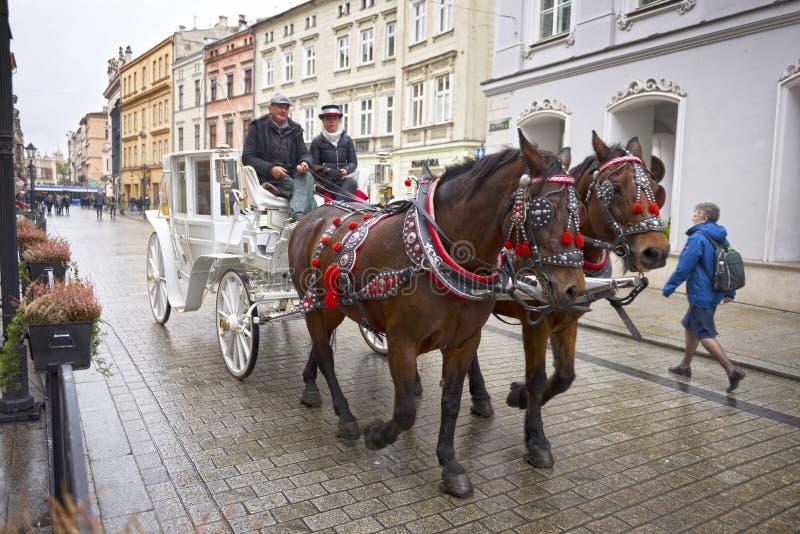 Oud vervoer in modern Krakau stock foto's