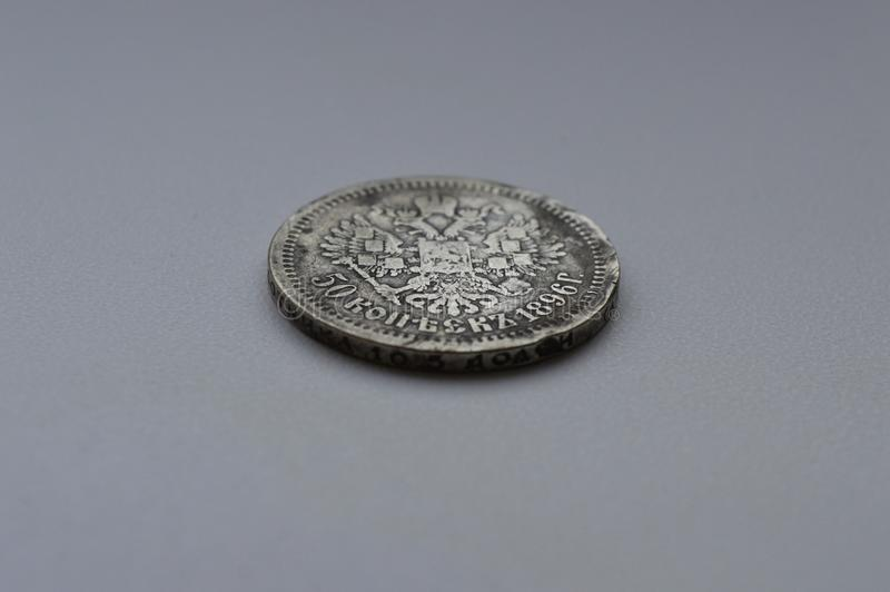 Oud zilveren muntstuk op een witte achtergrond royalty-vrije stock afbeeldingen