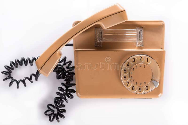Oude analoge telefoon - telefoonpictogram of contact royalty-vrije stock fotografie