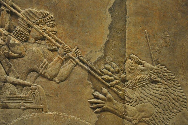 Oude Assyrian Lion Hunting Relief stock afbeeldingen