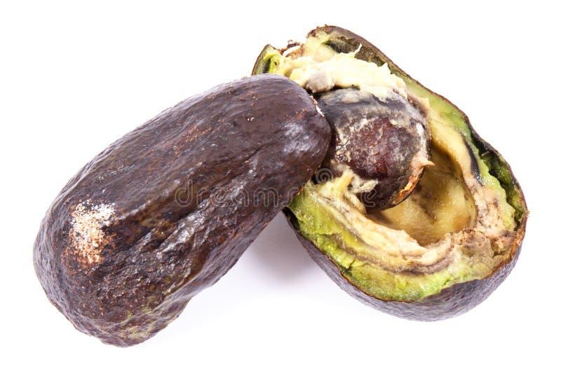 Oude avocado met vorm op witte achtergrond, ongezond voedsel stock foto