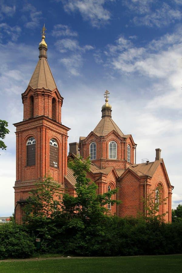Oude baksteenkerk stock afbeeldingen