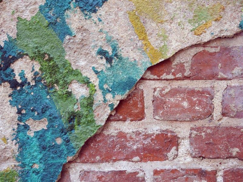 Oude bakstenen muur en geschilderde muur stock afbeelding