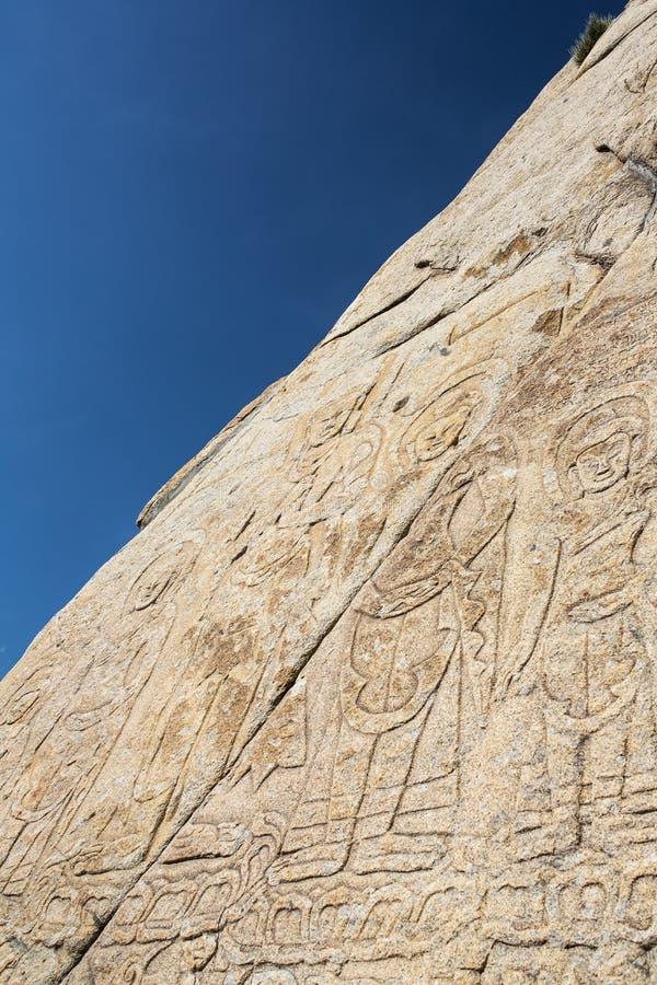 Oude boeddhistische gravure op de muur van Shey-Paleis complex in Ladakh royalty-vrije stock afbeelding