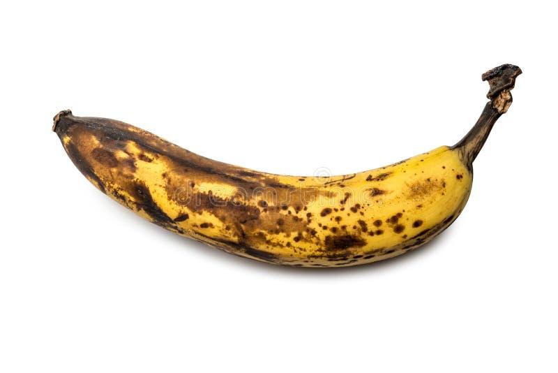 Oude bruine banaan als symbool van leeftijd en het verouderen op wit geïsoleerde achtergrond stock afbeelding