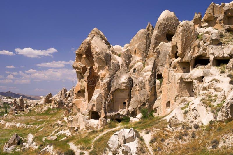 Oude cavetown dichtbij Goreme, Cappadocia, Turkije Mening aan klippenwoningen stock foto's
