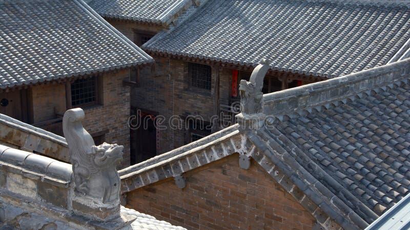 Oude Chinese Huizen en Binnenplaatsen met Grey Green Tile Roofs royalty-vrije stock afbeeldingen