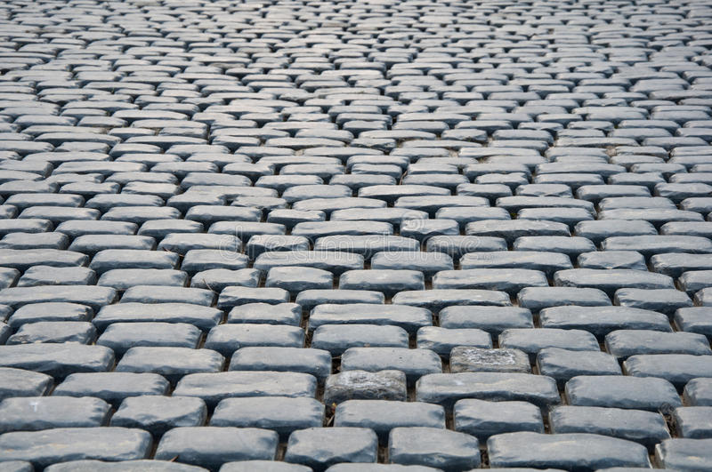 Oude cobble steen of achtergrond stock foto