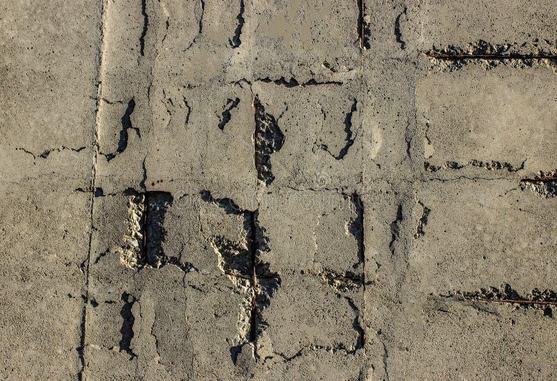 Oude concrete beschadigde oppervlakte stock afbeeldingen
