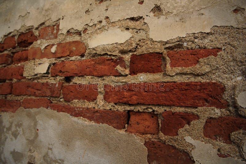 Oude concrete muurbaksteen stock afbeeldingen