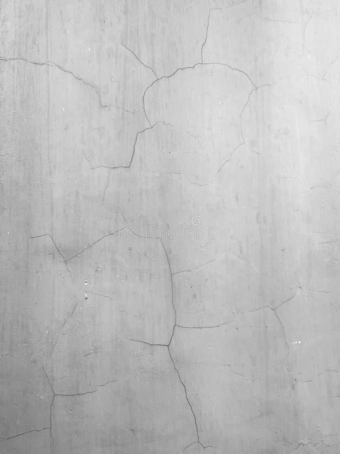 Oude concrete muurtextuur met krassen en barsten op oppervlakte stock fotografie