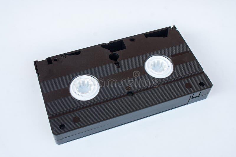 Oude de Videodiebandcassette van VHS op witte achtergrond wordt geïsoleerd stock fotografie
