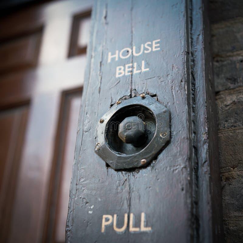 Oude deurklok stock afbeelding
