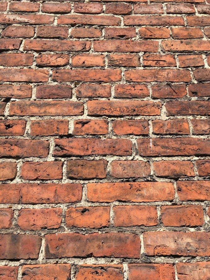 Oude die bakstenen muur van rode baksteen wordt gemaakt royalty-vrije stock foto