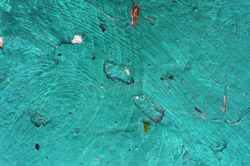 Oude die ijzeroppervlakte in turkooise kleur wordt geschilderd royalty-vrije stock afbeeldingen