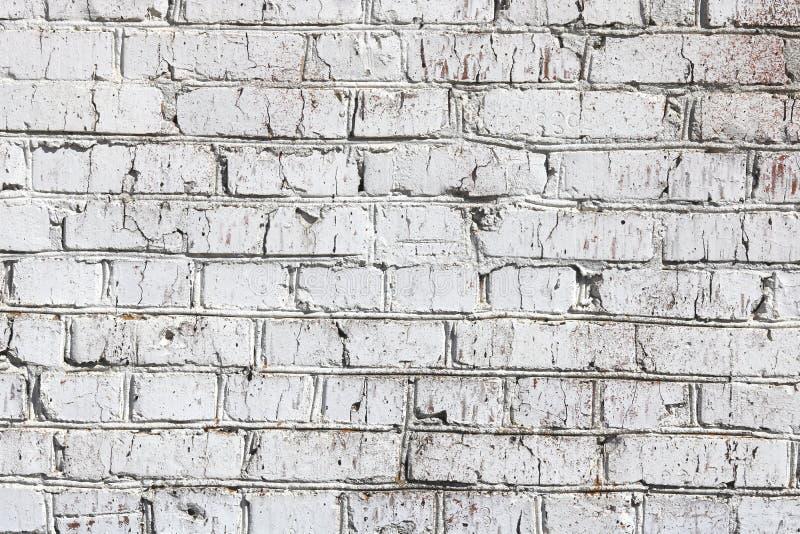 Oude die muur van rode baksteen, geschilderd wit in zolderstijl wordt gemaakt voor modern ontwerperbinnenland van ruimte stock afbeeldingen