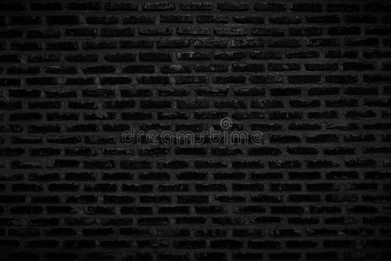 Oude Donkere Zwarte Bakstenen muurtextuur en Achtergrond stock afbeeldingen
