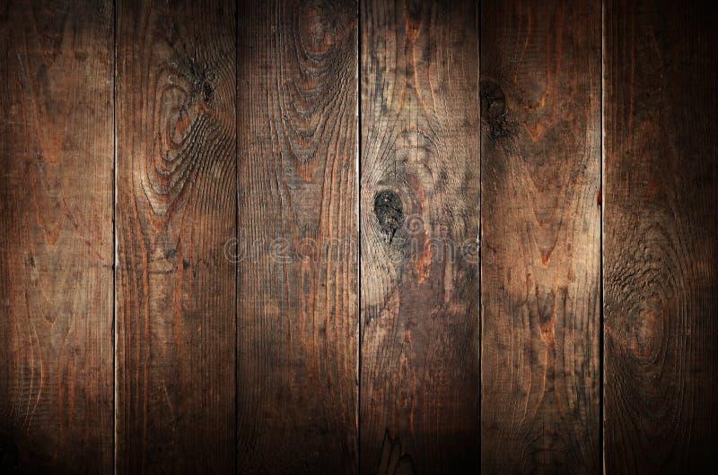 Oude doorstane houten planken. stock afbeelding