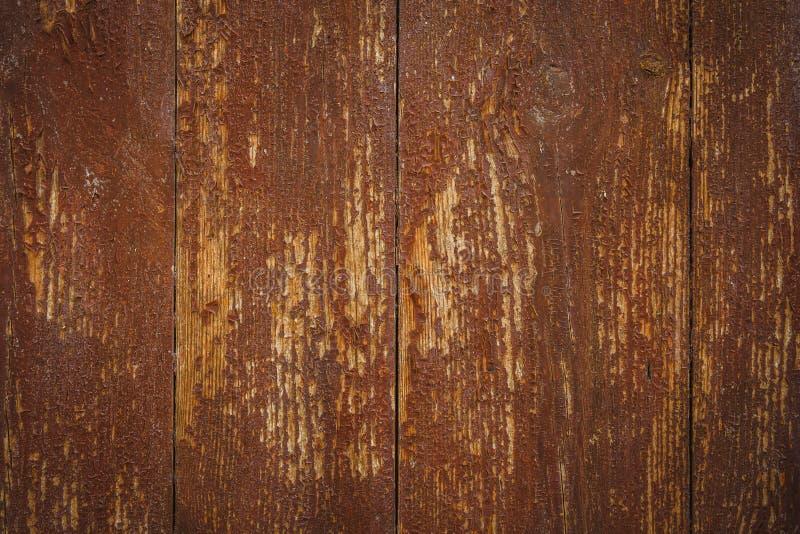 Oude doorstane uitstekende rustieke houten textuur als achtergrond met gekraste verf royalty-vrije stock foto