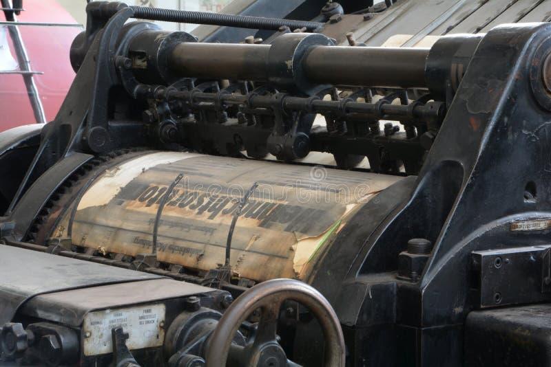Oude drukpers stock afbeelding