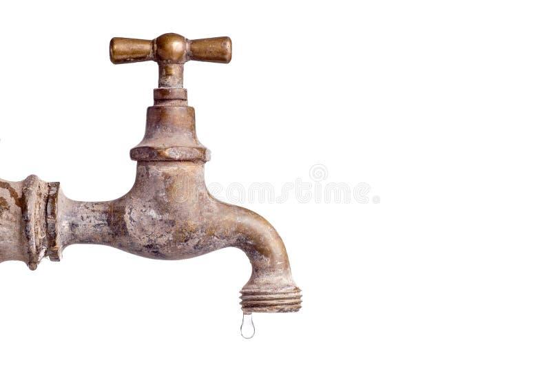Oude en gebruikte Uitstekende tapkraan met waterdaling stock fotografie