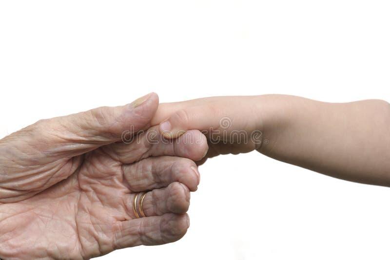 Oude en jonge die handen, op wit worden geïsoleerd royalty-vrije stock afbeelding