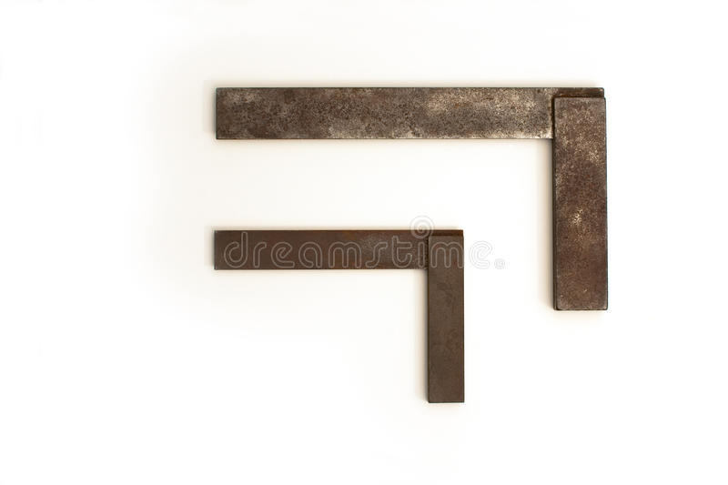 Oude en roestige timmerliedenvierkanten stock foto's
