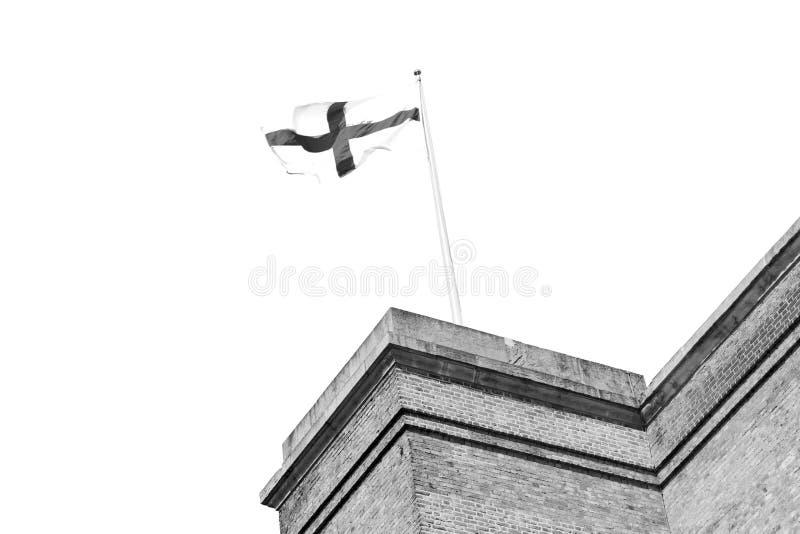 oude Engelse vlag in de muur en de hemel royalty-vrije stock foto