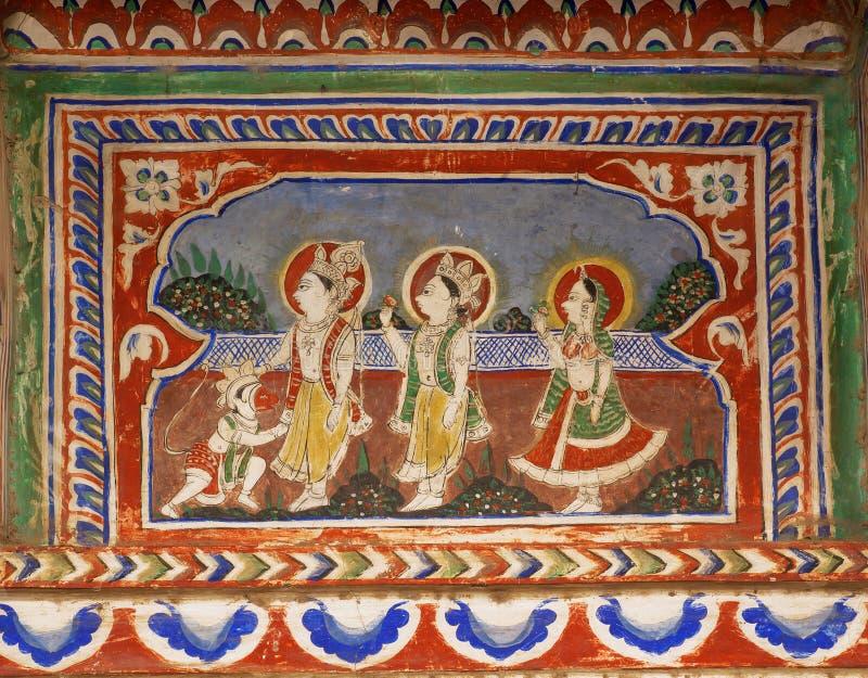 Oude fresko met Lord Rama en Hanuman-aap op oud huis stock foto