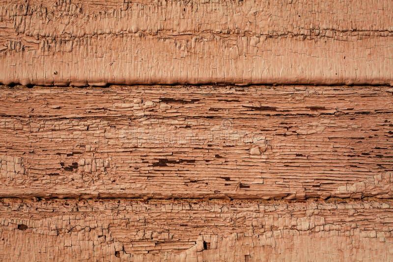 Oude gebarsten gele houten textuur stock foto's